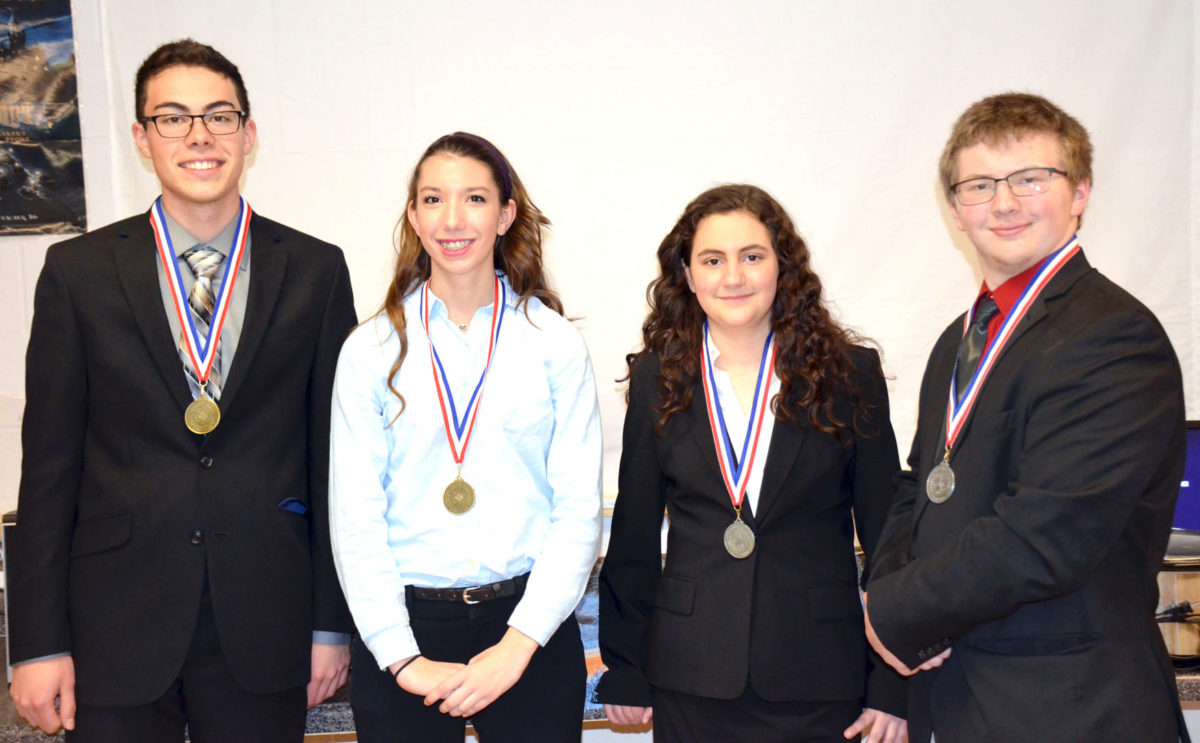 Devine Debate teams qualify for State