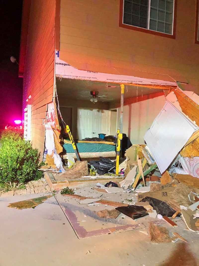 Truck busts through wall of apartment