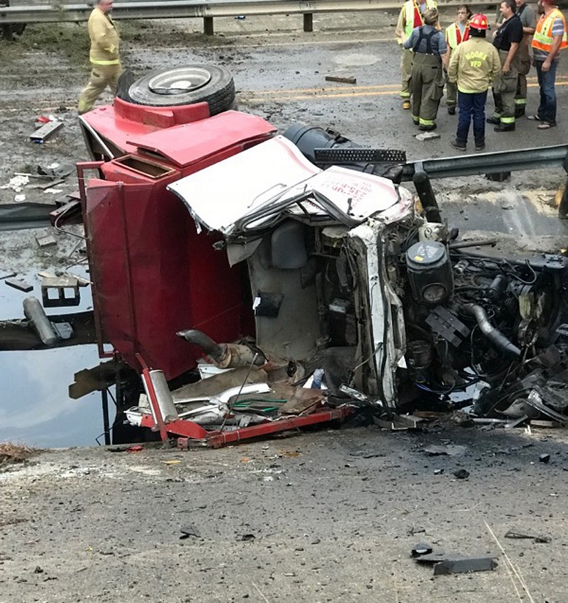 Truck plunges off I-35 at overpass, rescuers cut out trapped man