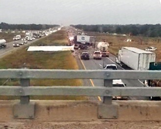 Two killed as 18-wheeler plunges across median, collides head-on