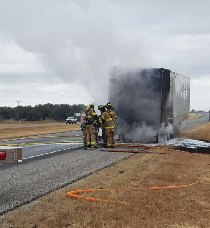 18-wheeler catches fire after tire blows