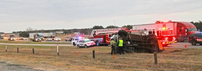 Three trucks roll in bizarre accident on I-35