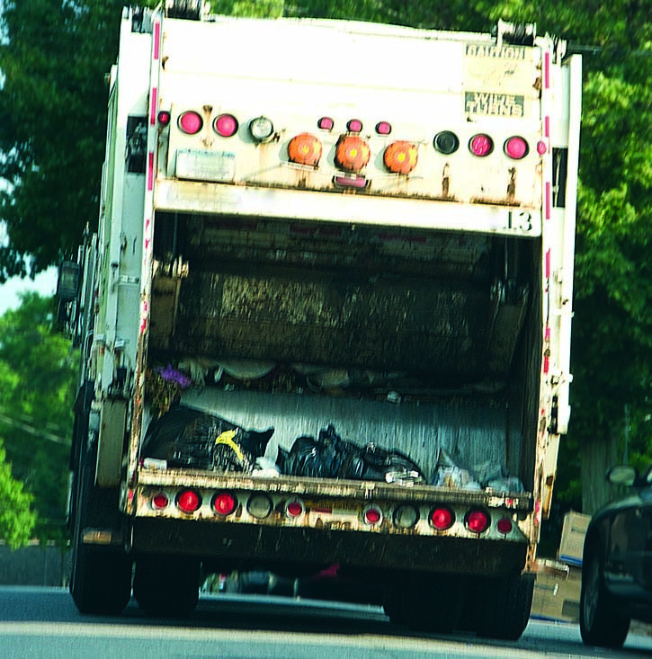 Two on garbage truck hospitalized in rare accident