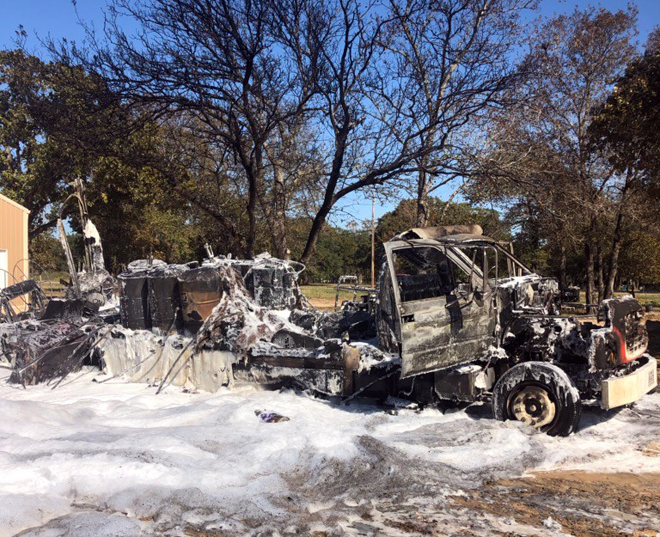 Trailer bursts into flames with two men inside